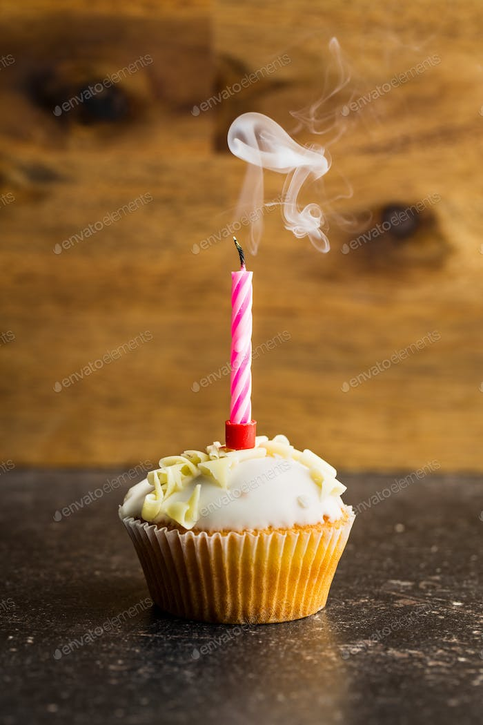 Cupcake with a candle blown.