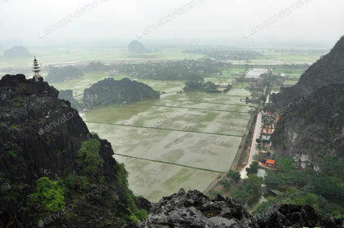 Rice fields, limestone rocks and mountaintop pagoda from Hang Mua Temple, Ninh Binh, Vietnam