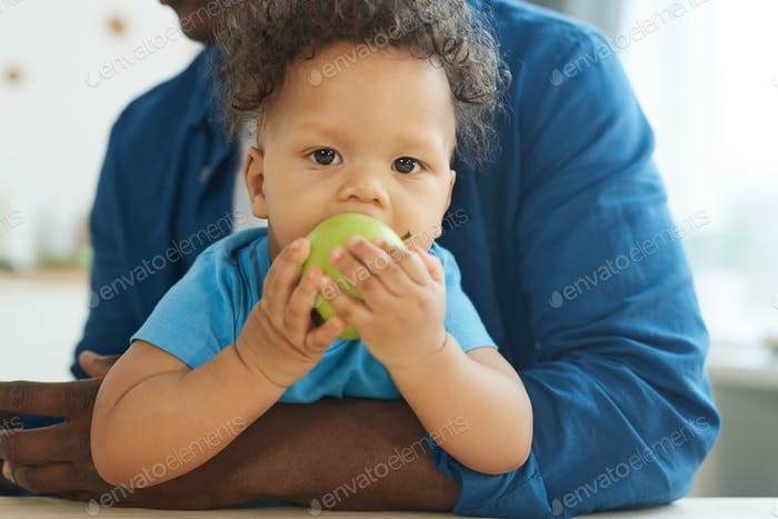 Cute Baby Eating Apple