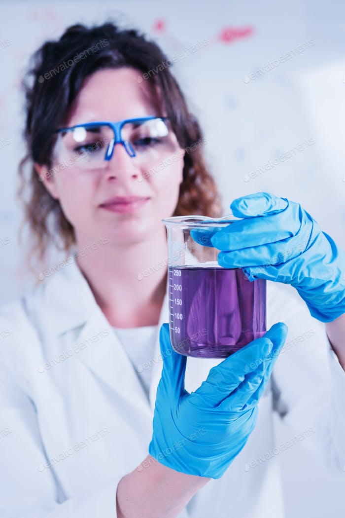 Young Female Scientist Doing Experiments In The Laboratory