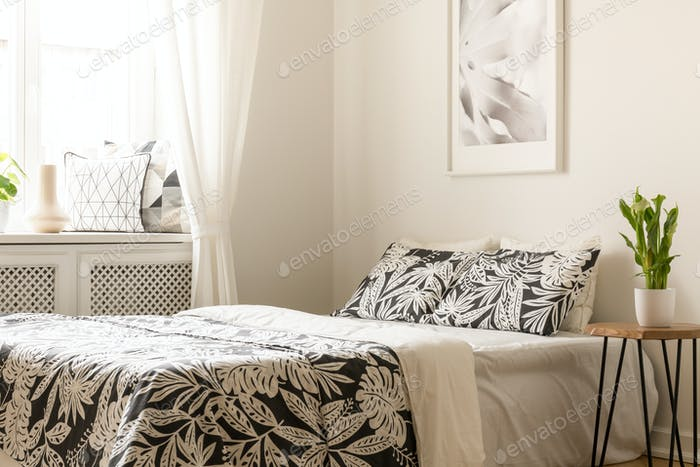 Plant On Table Next To Bed With Patterned Sheets In Bright Bedro Mesmerizing Patterned Sheets