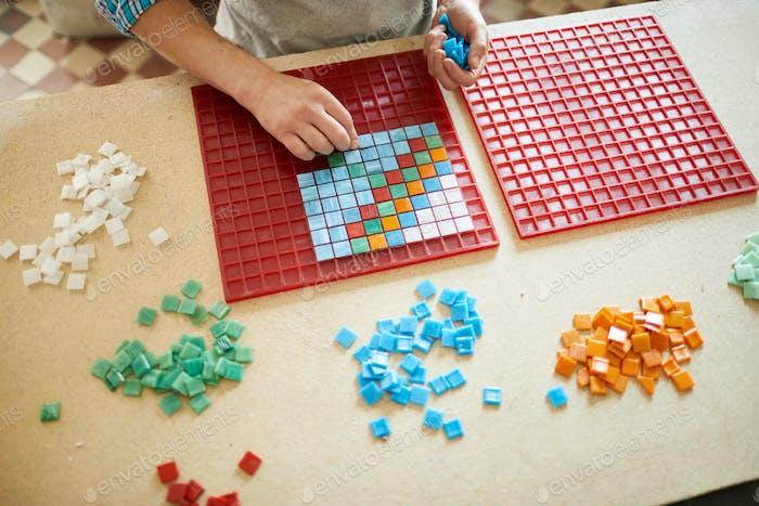 Unrecognizable Artist Making Mosaic Pattern