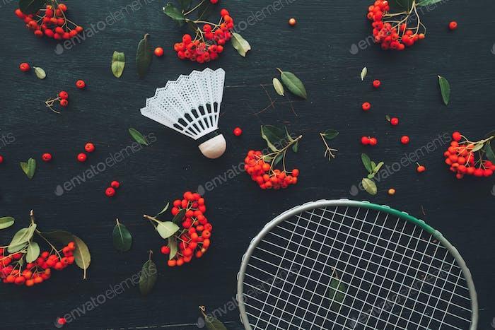 Flat lay badminton racquet and shuttlecock