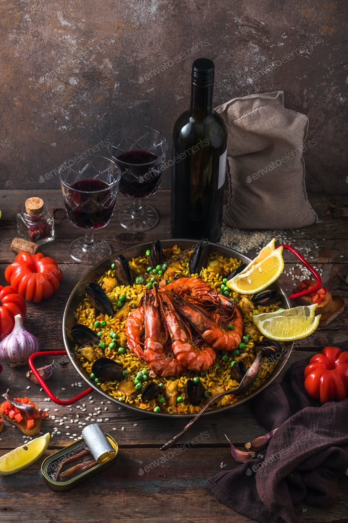 Paella with seafod and checken or paella mixta in a pan
