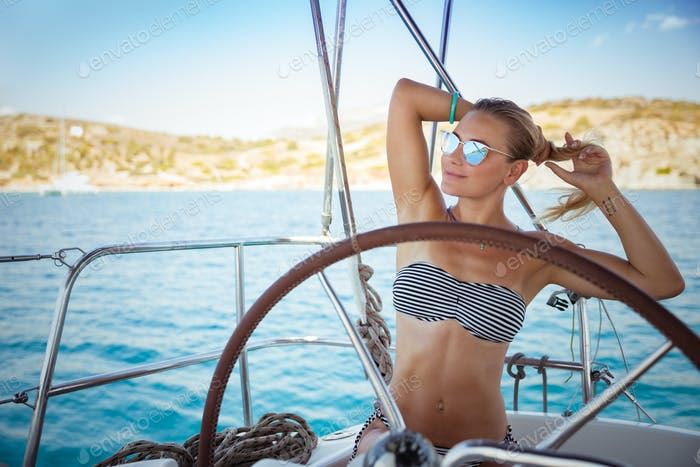 Beautiful girl on sail boat