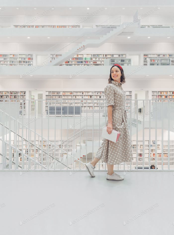Happy woman in the library