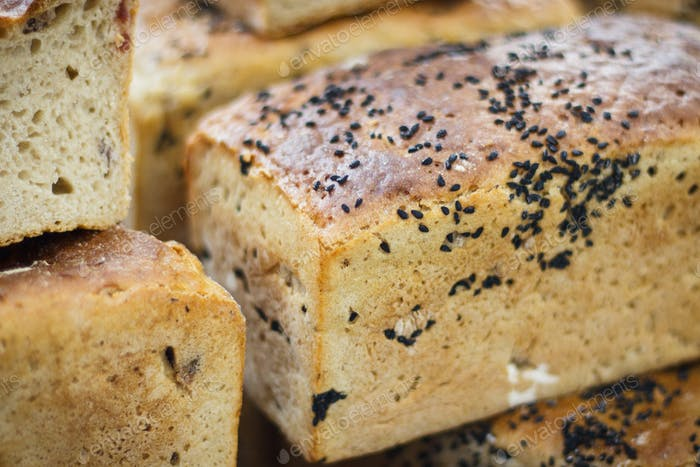 Fresh loaves of rye or wheat bread