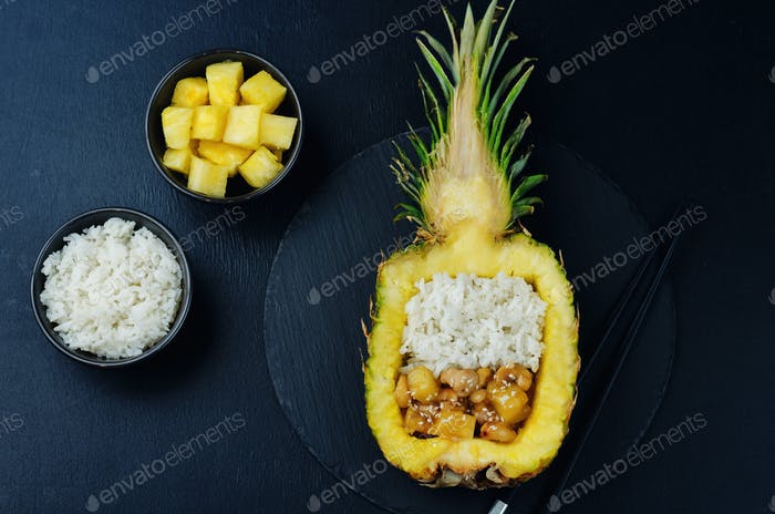 Pineapple stuffed rice with pineapple cashews chicken