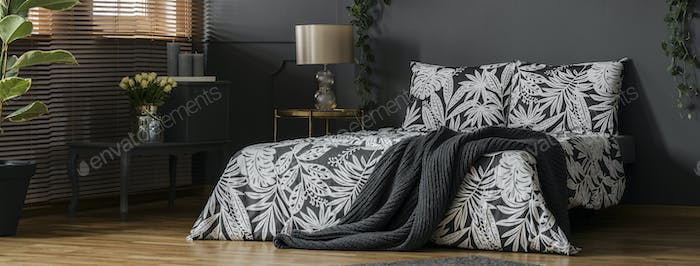 Bed against black wall