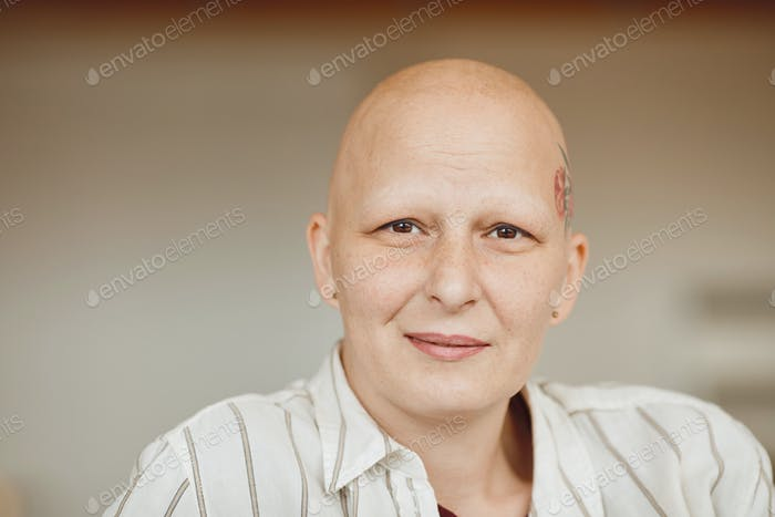 Modern Bald Woman Smiling at Camera