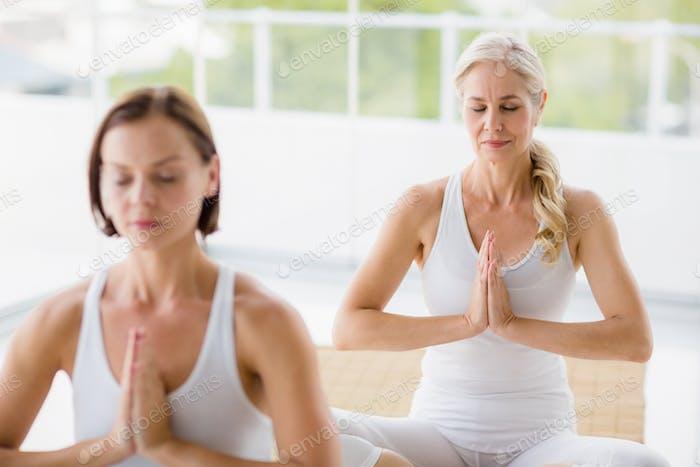 Women performing yoga
