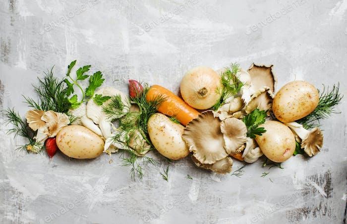 Raw potatoes, oyster mushrooms, carrots, onions, parsley, garlic