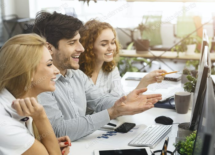 Professional colleagues reading investment results on computer screen
