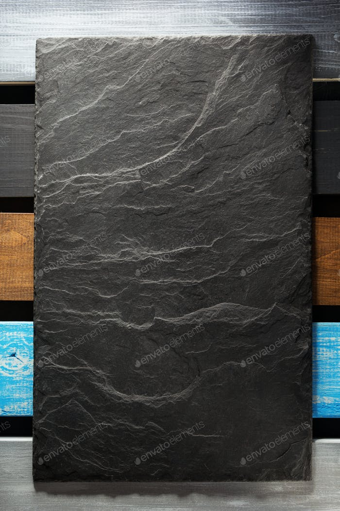 slate stone at wooden background