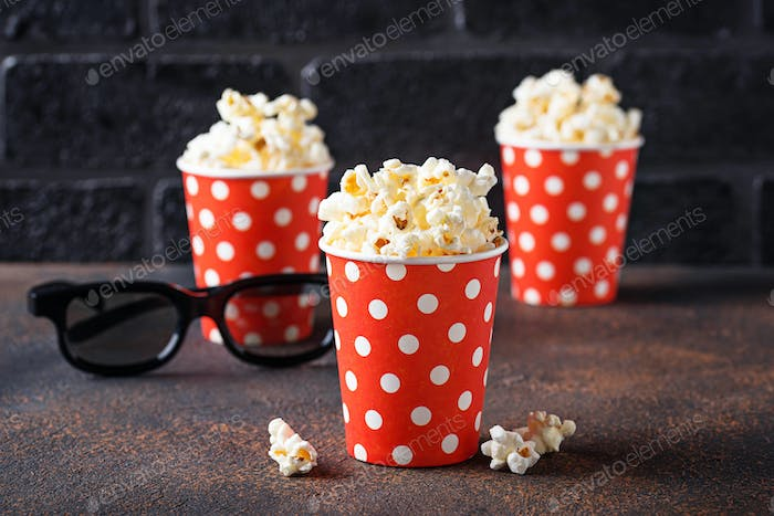 Popcorn with 3d glasses on dark background