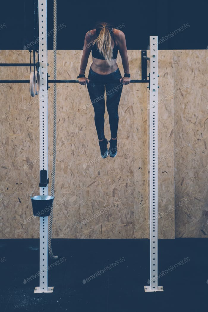 Girl doing muscle up exercise