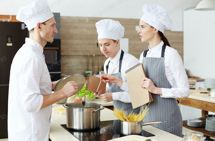 Cooking students questions at practical class