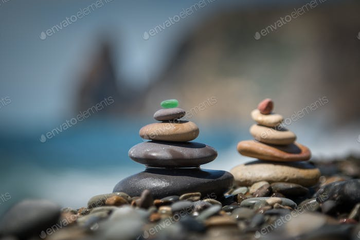 Pyramids of colorful stones on the seashore