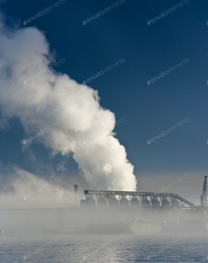 49962,Steam Rises from Riverfront Factory