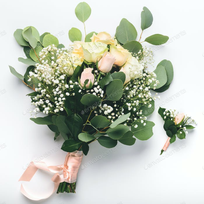 Bridal bouquet of cream roses on white background