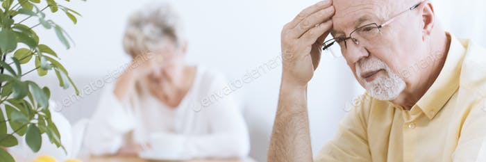 Worried elderly man and woman