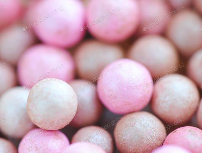 Pink cosmetics rouge balls, macro