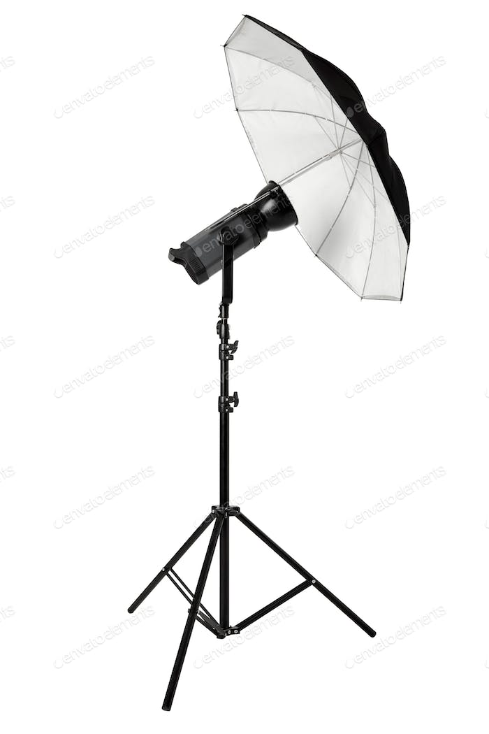 Studio flash with umbrella and stand isolated on white, clipping