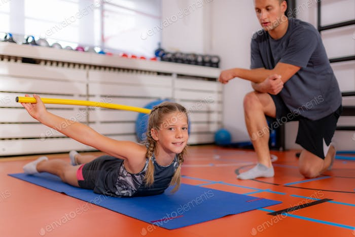 Back strengthening exercise for children with a bar