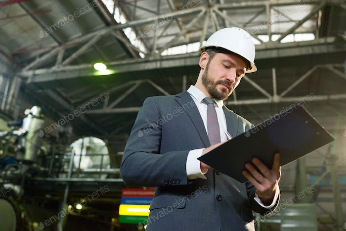 Handsome Businessman at Plant