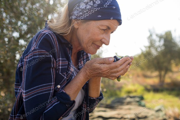 Woman smelling fresh olives