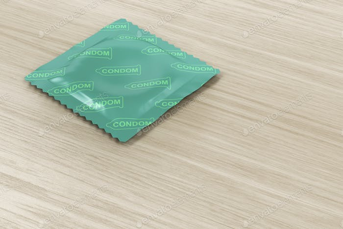 Condom on wood background