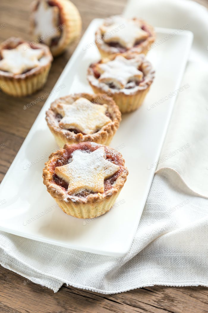 Mince pies with Christmas tree branch