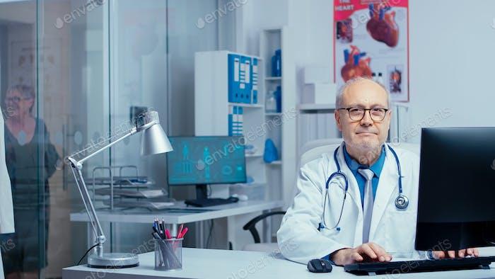 Doctor looking at camera
