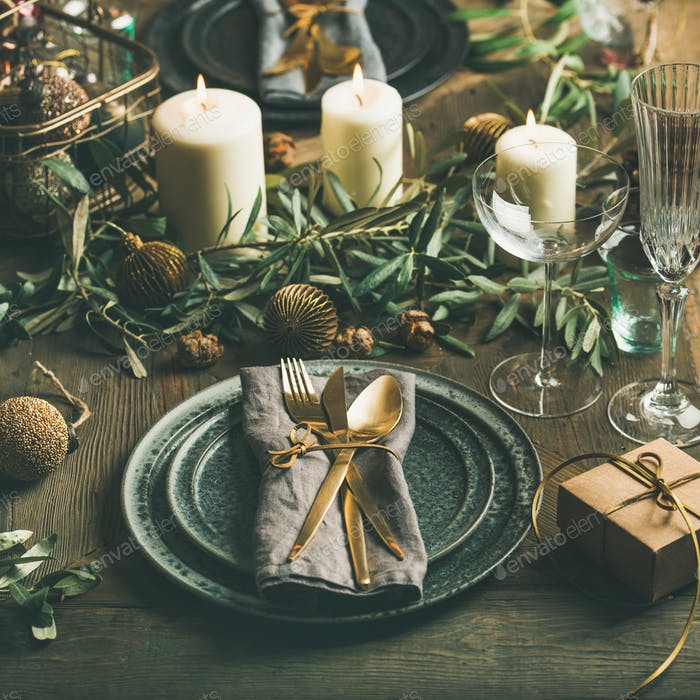 Christmas or New Years table setting with decoration, square crop