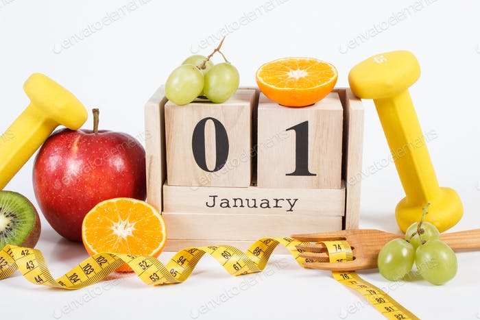 Cube calendar with date of 1 January, fruits, dumbbells and tape measure