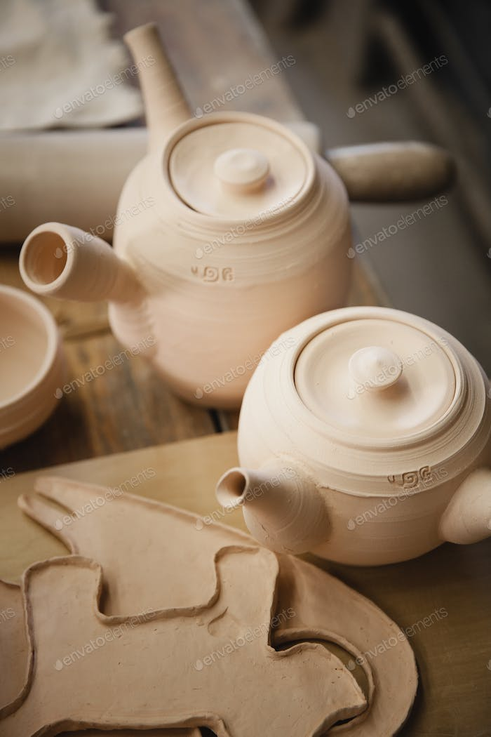 Roasted ceramimc teapots without glaze closeup