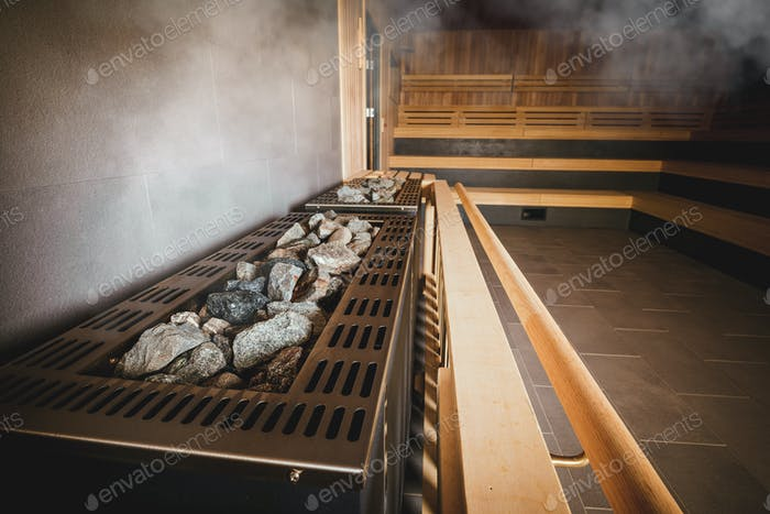 Big heater in Finnish sauna with hot stones
