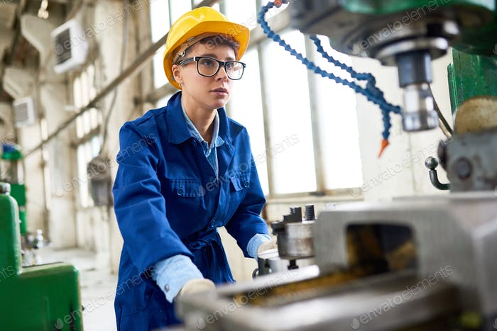 Female Machine Operator at Modern Plant