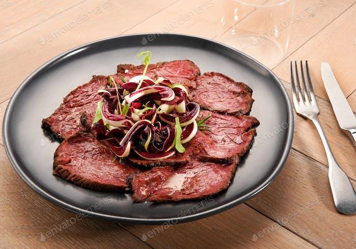 Sliced roast beef with radicchio salad