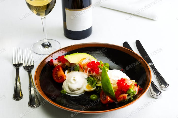 Seafood salad with red caviar and vegetables