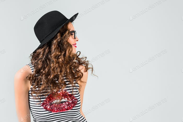 The girl in glasses and hat