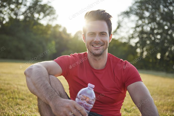Smiling man resting after workout on the fresh air