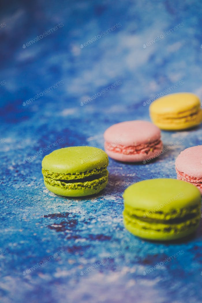 Thumbnail for Variety of colorful macarons over a blue background