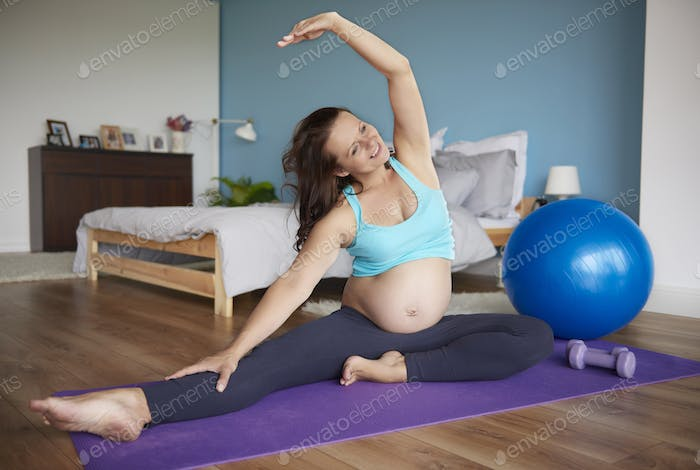 Future mother stretch in the bedroom