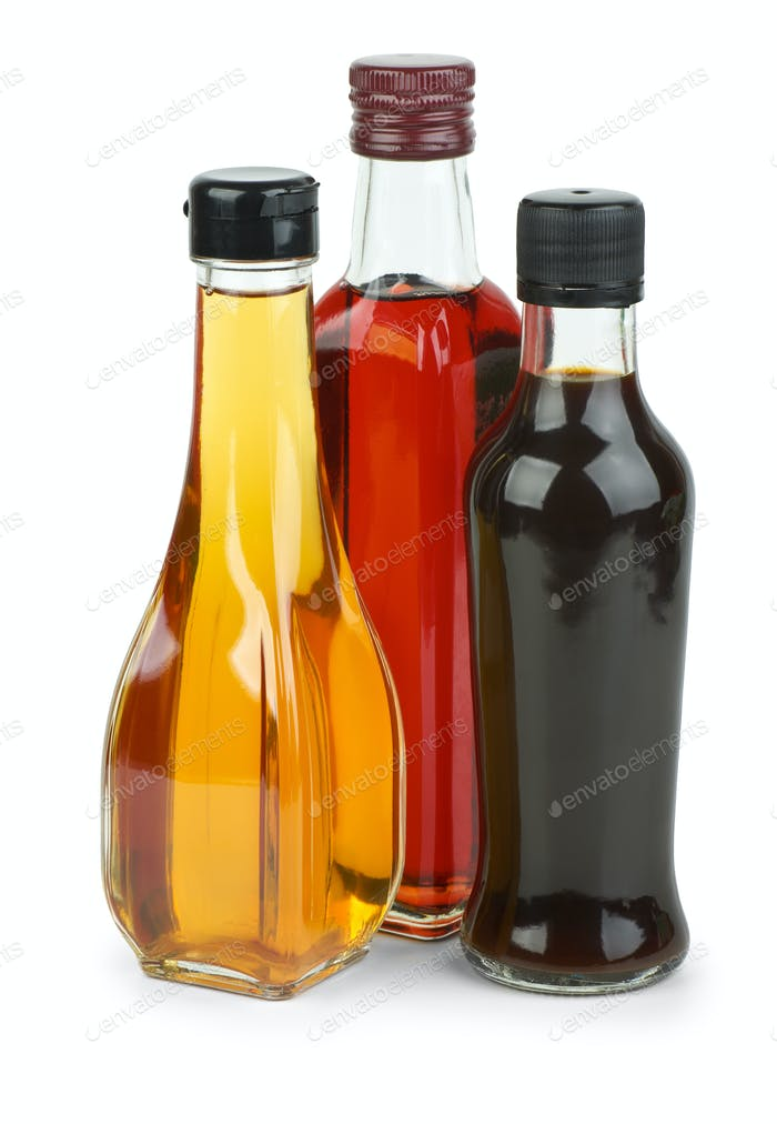 Bottles with apple and red wine vinegar and soy sauce