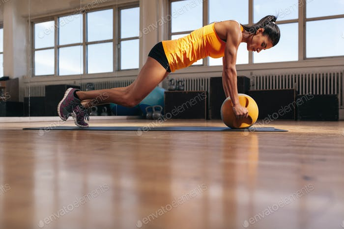 Female athlete working out on her core muscle