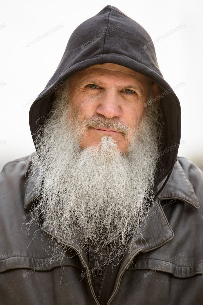 Face of mature bearded hipster man wearing hood