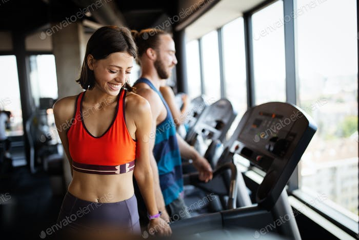 Close up image of attractive fit woman in gym
