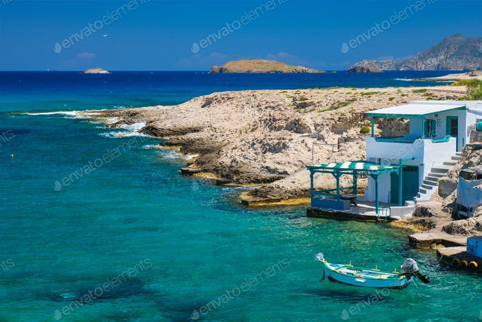 Crystal clear blue water at MItakas village beach, Milos island, Greece