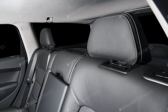 back seats of modern luxury car interior, black leather headrest